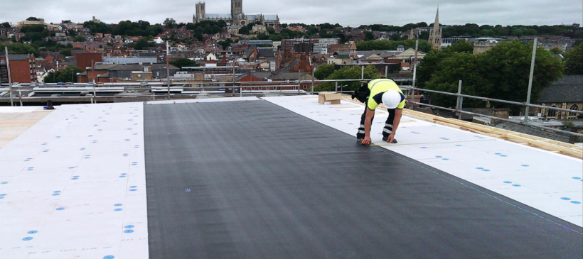 What Goes into Flat Roof Construction?